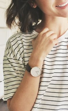 Daniel Wellington watch paired with a striped shirt.