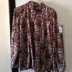 Loose fitted blouse Comfy , lovely paisley  print like , missing last button!! Still great condition Tops Button Down Shirts
