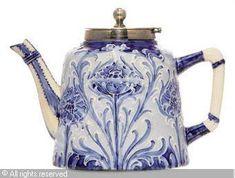Moorcraft Manufactory, c. 1912 (United Kingdom) Florian ware poppy teapot, sugar bowl and covered bowl.
