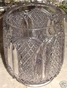 FROM THE 1880'S IS A VERY LOVELY ANTIQUE SUN PURPLE EAPG FOOTED LARGE COOKIE-BISQUIT JAR, CANISTER OR CANDY JAR---EAPG...EARLY AMERICAN PATTERNED GLASS.... LITTLE DIAMONDS WITH 4 TINY HOBNAIL DIAMOND