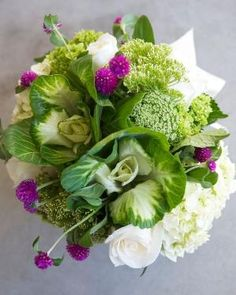 Ornamental cabbage and clover mixed with hydrangeas, sedum and roses by BGM Inspiration