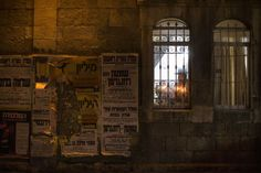 Dec. 1, 2013. An Ultra-Orthodox Jewish man prays and lights candles with his family on the fifth night of the Jewish holiday of Hanukkah, the festival of lights, at the ultra-Orthodox neighborhood of Mea Sheaarim in Jerusalem.