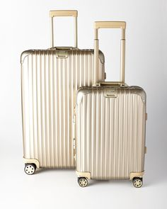 Gold Rimowa North America Topas Titanium Luggage with interior garment bags