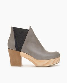 7839077d2c An unconventional wooden clog bootie. Fused together tonal woods and a pop  inlay sole bring