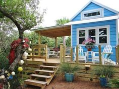 """This is a cute house!!!! Cheery Beach Cottage - This tiny beach cottage on Florida's St. George Island is called """"Our Little Secret"""" by its owners. Including the loft space, the 325-square-foot cottage sleeps two to four people, while a generous deck expands the living space into the outdoors for a perfect vacation retreat."""