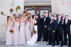 Wedding party photo idea - bridesmaids + groomsmen cheer as the newlyweds kiss! {Jill Gum Photography}
