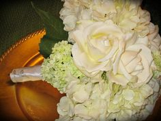 hydrangea and rose white wedding bouquets | so pretty?! Ivory roses, viburnum, and hydrangeas wrapped with white ...