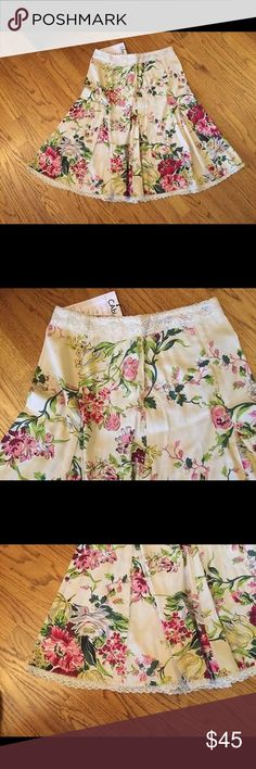 """🆕 CAbi O'Hara Skirt crochet trim Beautiful 100% cotton skirt with crochet trim at waist and hem. Back zip entry. Machine wash and dry. Waist across 14"""". Length 25"""". Brand new with tag. Retail price $89. CAbi Skirts A-Line or Full"""