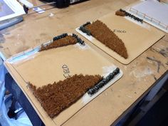Fields under construction.  Hardboard base, resin walls, door mat for the corn.