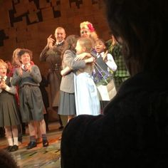 Tasha Chapple in her last show as Matilda in Matilda the Musical West End, being given her flowers by Lottie Sicilia