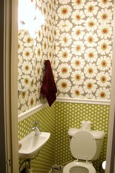 we lined the wall with sheets of wrapping paper from Paper Source along with wallpaper adhesive on the back and Mod Podge on the top to protect it and converted a standard sink to a tiny sink.""
