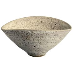 Bowl with with matte pale brown pitted glaze by Lucie Rie