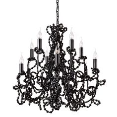 From Lightology. Coco Small Chandelier Round is made of steel draped with crystals.