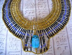 Handmade in Egypt by local craftsman. This outstanding and stunning necklace is handmade in true ancient Egyptian tradition with seed beads and genuine handmade exrea large Egyptian scarab bead.    The perfect piece of jewelry for an Egyptian fancy dress costume. $75.00