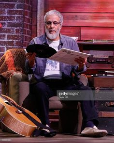 Yusuf Islam, formerly known as Cat Stevens, listens to a Beatles record onstage…