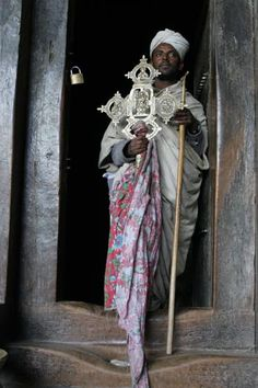 Ethiopia - A Lalibela Priest holding a beautiful Ethiopian Processional Cross