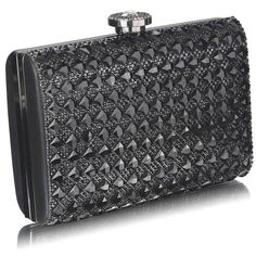 Diamanté clutch bag with jewelled top fastening in black. This is a stunning bag! It has a removable chain shoulder strap and a lined interior also comes in a gorgeous display box with a ribbon. handbagandheel.com