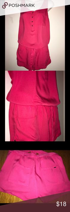 "PINK GARAGE ROMPER WITH OPEN BACK SIZE S/P 💞 Sleeveless Romper from GARAGE Clothing Store.  Gentle bodice flutters the surplice bodice and leg-flaunting cuffed shorts. A nipped-in waist for a flattering, figure-defining silhouette. Front and back pockets add interest. *Actual color is the bottom 4 photos.                                     Size: S/P Waist: 26""                                                           Leg opening: 24""                                                 100%…"