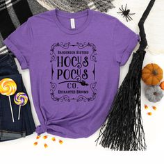 Hocus Pocus Co Shirt Halloween Shirts Hocus Pocus T-shirts Halloween T-shirt For Women Sanderson Sister Shirt It's just a bunch of hocus pocus - or is it? Seems to be the question we all ask ourselves at times but this shirt is not for deep thinking. It's for fun times, Halloween vibes, movie flashbacks and hopefully some great new memories because a little Hocus Pocus never hurt anybody as long as everyone's having fun. Want a long sleeve shirt? Don't hesitate to touch base and we will let you Halloween Clothes, Halloween Outfits, Halloween Shirt, Hocus Pocus Shirt, Sanderson Sisters, Bazaar Ideas, Deep Thinking, Sister Shirts, Jessie