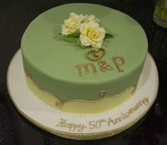 Anniversary Cake A gold anniversary cake in green, yellow and gold with hand-made pale yellow gum paste roses on top. Wedding Cakes One Tier, One Tier Cake, 50th Wedding Anniversary Cakes, Anniversary Parties, 50th Party, Occasion Cakes, Cupcake Cakes, Cupcakes, Pretty Cakes