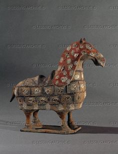 CHINESE SCULPTURE 6TH Horse with saddle and armour. Funerary statuette. Northern Wei, 5th-6th CE The Chinese cavalry was created at about that time against the invasions of Mongol horsemen. MA 3917 Musee Guimet, Paris, France