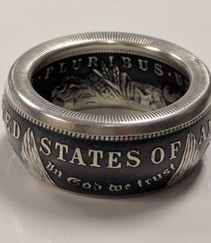 Coin Ring for Men – Morgan Silver Dollar Coin Ring Makes a Unique Ring for Him and a Beautiful Coin Jewelry Piece in 3 Finishes Coin Jewelry, Silver Jewelry, Silver Rings, Jewellery, Silver Dollar Coin, Morgan Silver Dollar, Wedding Band Styles, Wedding Bands, Coin Display