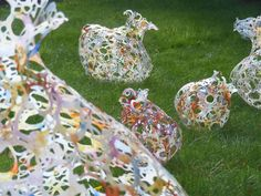 Bottle Art Projects for Outside | out these amazing vessels made from recycled plastic milk bottles ...
