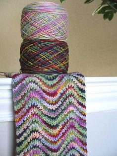 knit ripple scarf with 2 variegated yarns (would have never thought to put these two together, but wow!)