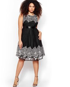 You deserve a plus size dress that will show off your stunning curves. This one is well cut with a fit and flare shape that flatters all silhouettes, shaped, slim, and curvy. It features a dominant color but the two-toned lace cuts in to add its delicate floral shapes at the hem and on the bodice. Self-tie belt, crew neck, 42 inch length. Michel Studio