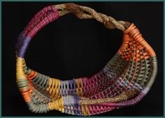 Cradle Rock basket-style by master weaver Tina Puckett