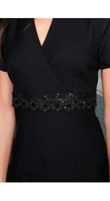 Black tunic with lace detail.