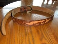 Price $14.00 Used belt that looks to me to be machine pressed and dyed and not hand done. Brown in color with eagles trailing along it that are done i...