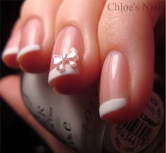 French mani with a girlie bow