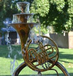 DIY / Repurpose French Horn Fountain.   I want to make one of these!