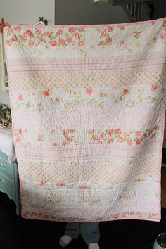 vintage sheet cut into strips and made into a quilt - very cool idea! I could do this!
