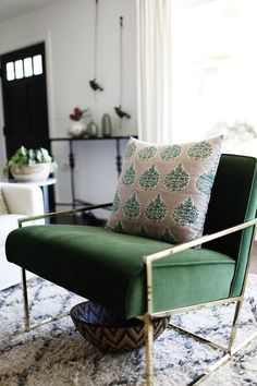 A Boldly Bohemian Home in Seattle | Rue // gorgeous emerald green chair