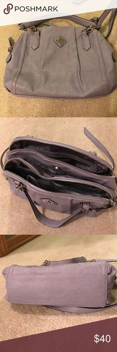 Lavender Vera Wang handbag Vera Wang handbag in lavender. Very gently used, no stains or rips. In like new condition! Has adjustable strap. Has 3 compartments, 2 zippered main compartments and a smaller magnetic center compartment. Also has 2 small interior pockets and a zippered interior pocket. Measures approximately 12x8x4.5 Vera Wang Bags Crossbody Bags