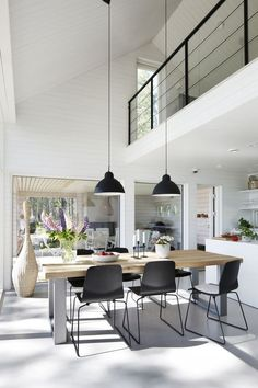 I love the second story balcony over the the kitchen, leaving such an airy vibe. The double light fixture is also very cool. House Design, Dining Room Design, Dinning Room Flooring, Home Decor, House Interior, Dining Table Black, Interior Design Living Room, Home Interior Design, Interior Design