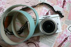 Olympus PEN E-P1 with iconic strap