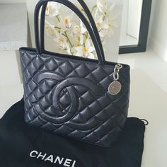 Chanel Medalion Caviar Black Leather Handbag 100% authentic from Chanel like new,  gorgeous classic bag never go out of style, been worn only few times. Going well with many outfits,  zippered closure and zippered pocket interior.  Coming with dust bag and authenticity card. CHANEL Bags Satchels