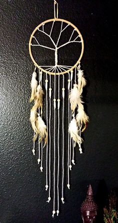 Dream catchers have been used for ages to filter out all bad dreams and only allow good thoughts and energy to slide down the feathers of the sleeper. Used as protective charms. Is absolutely one of a kind and hand made from start to finish.  Aprox. 8 inches wide / 31 inches long  *International shipping available upon request