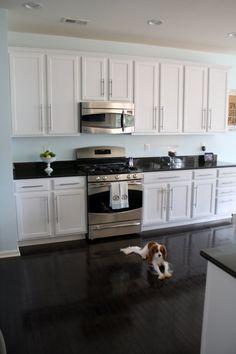 White cabinets, dark floor, wall color  sherwin williams Lauren's Surprise