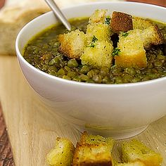 Healthy lentils and peas soup with diced toasted bread