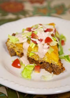Impossible Taco Pie - kind of like a crustless taco quiche - SO good and easy! Top favorite taco toppings.