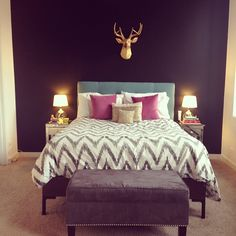 gorgeous bedroom with dark walls. love the white bedspread and colorful pillows. keeps it from being too dark.