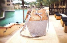 A small bucket bag with a grey paper-leather base and natural cork fabric at top with silver speckles. This bag is free of leather. Cork Fabric, Everyday Bag, Leather Bags, Saddle Bags, Bucket Bag, Shopping Bag, Base, Natural