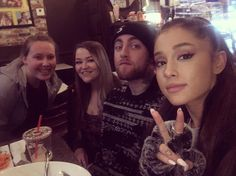 Ariana Grande and Mac Miller with fans at a restaurant in Los Angeles, CA. (November 26th)