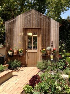 Greenhouse - this is the front, sides are glass.  Lovely!  From: Velvet & Linen blog.
