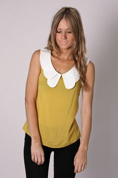 This top could look cute tucked into high waisted jeans or over skinnys!