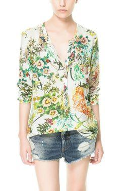 Blusa manga longa em chiffon com estampa tropical. R$ 89,90 com frete grátis para todo o Brasil